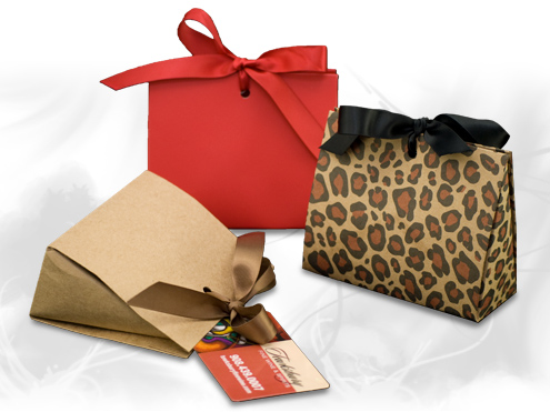 Ribbon tied purse shaped gift boxes
