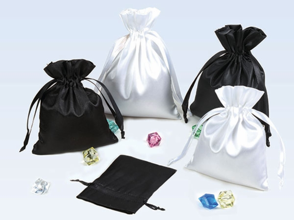 White and black satin drawstring pouches